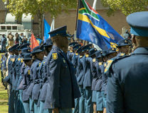 South African Police  Services on Parade in the arean in formation , side view, flag unfurled and flying Stock Photo