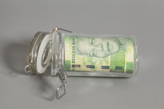 South African Rand in a glass jar Royalty Free Stock Photography