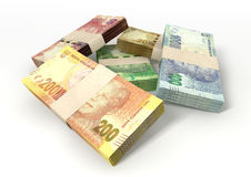 South African Rand Notes Bundles Stack. A scattered pile of bundled south african rand bank notes on an isolated background Royalty Free Stock Image