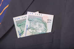 South african Rands in the pocket of a suit. South African Rand in the pocket of a suit, background Royalty Free Stock Photography