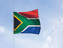 South African Republic flag in  wind against the sky Stock Image