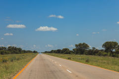 South African road through the savannas and deserts with marking Stock Photos