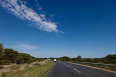 South African road through the savannas and deserts with marking Stock Photo