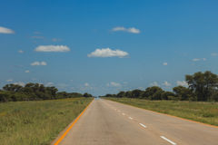 South African road through the savannas and deserts with marking Stock Images
