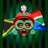 South african soccer fan. In ball-helmet and funny glasses Stock Photo