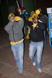 Soccer Fans Blowing a Vuvuzela Stock Image
