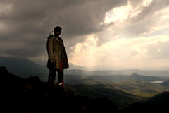 South African Tourism. Silhouette of an Sothu young man in the Drakensberg- mountains royalty free stock photo