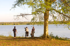 South African Tourism. Tourists at Nsumo Pan, uMkhuze KZN Park, in South Africa. South Africa had an impressive growth of 10.2% in international tourist visitors Stock Photography