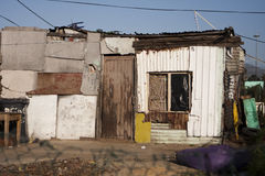 South African Township Home. A fairly typical home in a South African township. These shacks are often built with whatever materials can be found stock photo