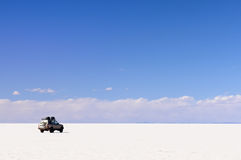 South America, Bolivia expedition. South America - Car on the Salar de Uyuni in Bolivia Royalty Free Stock Photography