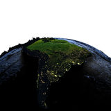 South America on Earth at night with exaggerated mountains. South America on model of Earth with exaggerated surface features including ocean floor at night. 3D Royalty Free Stock Photo