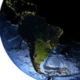 South America on Earth at night with exaggerated mountains. South America on model of Earth with exaggerated surface features including ocean floor. 3D Royalty Free Stock Images