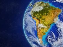South America on globe with borders. South America from space on model of planet Earth with country borders and very detailed planet surface and clouds. 3D royalty free illustration