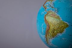 South America map on a globe with a white background.  stock images