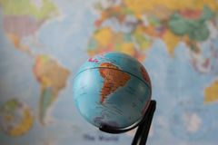 South America map on a globe. With the whole world as background stock images