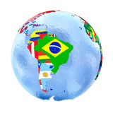 South America on political globe with flags isolated on white Royalty Free Stock Photo