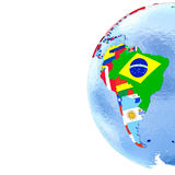 South America on political globe with flags Stock Photos