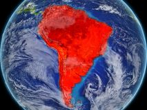 South America on realistic model of planet Earth with very detailed planet surface and clouds. Continent highlighted in red colour. 3D illustration. Elements royalty free illustration