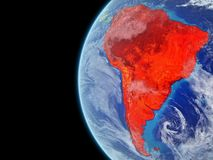 South America in red on globe. South America from space on model of planet Earth with very detailed planet surface and clouds. Continent highlighted in red. 3D vector illustration