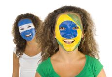 South America rule!. Portrait of young, Argentinian and  Brazilian sport's fans with painted flags on faces. Smiling and looking at camera.  Front view, white Royalty Free Stock Photo