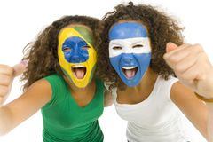 South America team. Young, screaming Brazilian and Argentinian  sport's fans with painted flags on faces and with clenched fists. Front view. Looking at camera Stock Photography