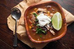 South American Aztec Soup. Fresh hot South American Aztec soup with cream and lime Stock Photos
