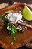 South American Aztec Soup. Fresh hot South American Aztec soup with cream and lime Royalty Free Stock Photo