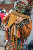 South American Indian buskers play traditional panpipe music Royalty Free Stock Image
