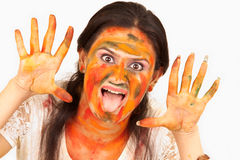South asia having fun with colors. South asia Girl having fun with colors stock image