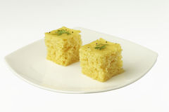 South asian indian gujarati lentil cake dhokla. South asian indian gujarati lentil cake dhokla in a plate Royalty Free Stock Images