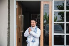 Man showing muslim greeting gesture. South asian man showing muslim greeting gesture in front of his house Stock Image
