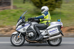 South Australian Police officer riding a BWM Police motorcycle. Adelaide, Australia - September 25, 2016: South Australian Police officer riding a BWM Police stock image