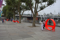 South Bank in London. LONDON, UK - CIRCA SEPTEMBER 2016: Tourists on the South Bank of River Thames royalty free stock photo