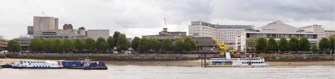 South Bank London. LONDON, UK - MAY 05, 2010: Panoramic view of the South Bank Centre on River Thames with (left to right) the National Theatre, the Queen Stock Image