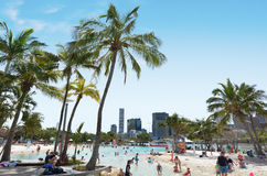 South Bank Parklands - Brisbane Australia. BRISBANE, AUS - SEP 25 2014:Visitors at Streets Beach in South Bank Parkland.It's Australia�s only inner-city, man Royalty Free Stock Images
