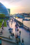 South bank of river Thames, London hall and walking people Royalty Free Stock Images