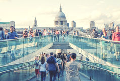 South bank walk of the river Thames. View on St. Paul's cathedral from foot bridge. London Stock Photo