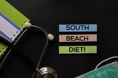 South Beach Diet! on top view black table and Healthcare/medical concept stock photo
