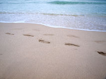 South beach footprints in sand Stock Photos