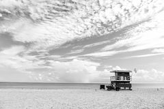 South Beach, Miami, Florida, lifeguard house in a colorful Art D. Eco style on cloudy blue sky and Atlantic Ocean in background, world famous travel location Royalty Free Stock Image