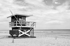 South Beach, Miami, Florida, lifeguard house in a colorful Art D. Eco style on cloudy blue sky and Atlantic Ocean in background, world famous travel location Stock Photography