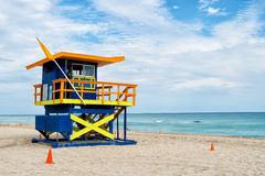 South Beach, Miami, Florida, lifeguard house in a colorful Art Deco style on cloudy blue sky. And Atlantic Ocean in background, world famous travel location Royalty Free Stock Images