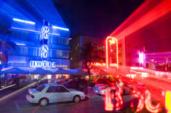 South beach miami hotels neon lights. SOUTH BEACH, MIAMI-APRIL 19: Cars and neon light streaks on Ocean  Drive in front of art deco hotels in South Beach, Miami Stock Image