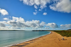 South Beach Tenby, with Caldey island. Royalty Free Stock Photos