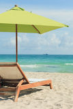 South Beach Umbrella and Lounge Chair Royalty Free Stock Image