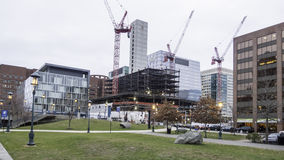 South Boston redevelopment seen from Children`s Wharf. South Boston, Massachusetts, USA - December 17, 2015: Construction at One Seaport Square viewed from Stock Photography