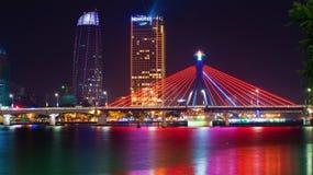 The South bridge on the background of the modern Novotel Danang Premier Han River. Night in Da Nang, Vietnam Royalty Free Stock Photography