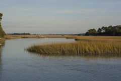 South Carolina Marsh. Salt marsh with wooden pier in from the Kiawah River in coastal South Carolina stock photo