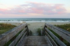 South Carolina nature background. Wooden boardwalk and stairs to the ocean beach over sand dunes in Huntington Beach State Park, Myrtle Beach area, South Stock Photo