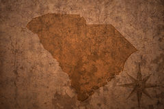 South carolina state map on a old vintage paper background. South carolina state map on a old vintage crack paper background Royalty Free Stock Image